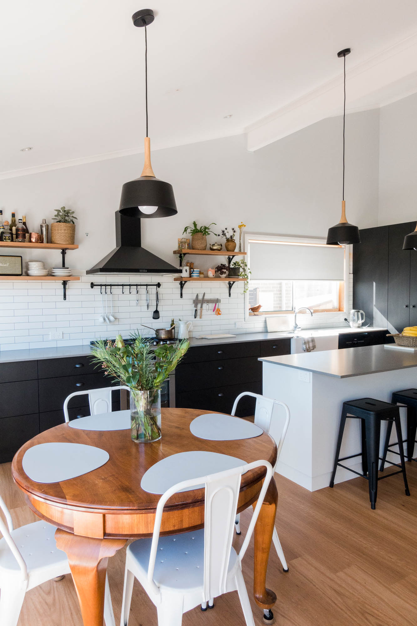 black kitchen with grey bench